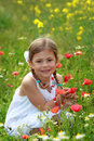 Girl holding a red poppy Royalty Free Stock Photos