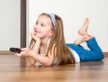 Girl holding a remote control Stock Photos