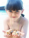 Girl holding seashell caucasian kid with blue eyes seashells on the tropical island Stock Image