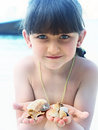 Girl holding seashell caucasian kid with blue eyes seashells on the tropical island Stock Photos