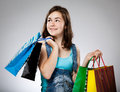 Girl holding shopping bag on gray background Royalty Free Stock Images
