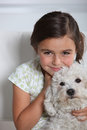 Girl holding small dog little white Stock Photos