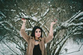 Girl Holding Snowy Tree Branches Royalty Free Stock Photo
