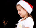 Girl holding sparkler Stock Photography