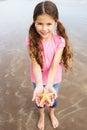 Girl Holding Starfish Found On Beach Royalty Free Stock Photo