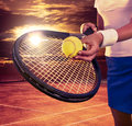 Girl  holding tennis  racket and ball on blue sky Royalty Free Stock Photo
