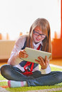 Girl  holding a touchpad tablet Royalty Free Stock Images