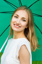 Girl holding an umbrella young smiling a green Royalty Free Stock Photo