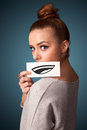 Girl holding white card with smile drawing pretty young on gradient background Royalty Free Stock Photo