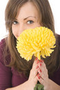 Girl holding a yellow flower and laughs Stock Images
