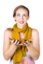 Girl holds autumn leaves wearing a yellow scarf catches falling Stock Photography