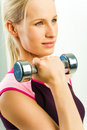 Girl holds barbell Stock Photo