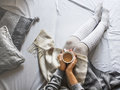 Girl holds a cup of hot coffee on a cold winter morning at home in bed Royalty Free Stock Photo