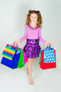 Girl holds many packages the color paper Stock Photos