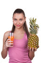The girl holds pineapple on a white background Royalty Free Stock Photos