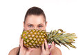 The girl holds pineapple on a white background Stock Images