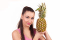 The girl holds pineapple on a white background Royalty Free Stock Photo