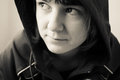 Girl in a hooded jacket black and white portrait of serious looking Royalty Free Stock Photos