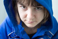 Girl in a hooded jacket portrait of serious looking blue Stock Photo
