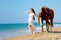 Girl with horse on the beach Royalty Free Stock Image