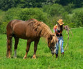 Girl with a horse beautiful on farm Royalty Free Stock Photography