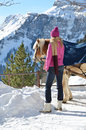 Girl and a horse braunwald switzerland Royalty Free Stock Photos