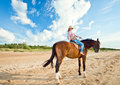 Girl with horse on seacoast young beautiful Stock Images