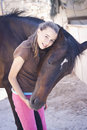 Girl and horse a teenage with her candid photo happy feeling best friends Stock Image