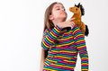 Girl and a horse toy. Royalty Free Stock Photo