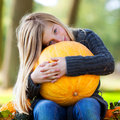 Girl with huge pumpkin Stock Photography