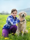 Girl hugging a big dog in an outdoor setting little blond with her pet outdooors park Royalty Free Stock Photos