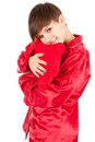 Girl hugging big red heart pillow Royalty Free Stock Photo