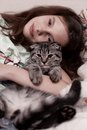 Girl hugging cute kitten Royalty Free Stock Photography