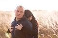 Girl hugging her boyfriend outdoors Stock Image