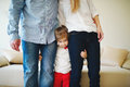 Girl hugging mom and dad for legs Royalty Free Stock Photo