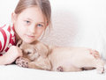 Girl hugging a puppy hand blue eyed little Royalty Free Stock Photography
