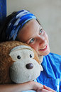 Girl hugging a soft toy Royalty Free Stock Images