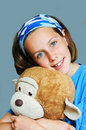 Girl hugging a soft toy Royalty Free Stock Photography
