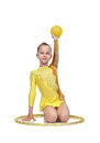 Girl with hula hoop and ball Royalty Free Stock Photo