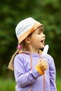 Girl with ice cream looks away Stock Image