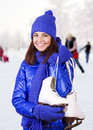 Girl with ice skate. Stock Photo