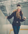 Girl on ice skating rink happy newbie Royalty Free Stock Images
