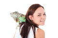 Girl with an iguana young adults in a white studio having fun Stock Photography