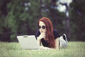Girl in indie style clothes with laptop computer Royalty Free Stock Photo