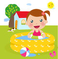 A girl in inflatable pool Royalty Free Stock Image