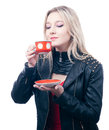 Girl inhales the aroma of tea Stock Images