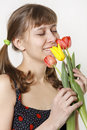 The girl inhales aroma of tulips Stock Photography