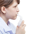 Girl inhales with mouthpiece of jet nebulizer medical inhalation treatment modern isolated on white background Royalty Free Stock Photo