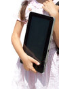 Girl with ipad like gadget isolated white background little Royalty Free Stock Images