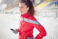 Girl with iphone in activewear spending leisure at stadium Royalty Free Stock Image